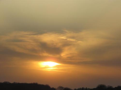 The clouds croud the setting sun